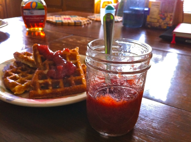 Gluten-free waffles and maple syrup with jam on top does a stomach good!